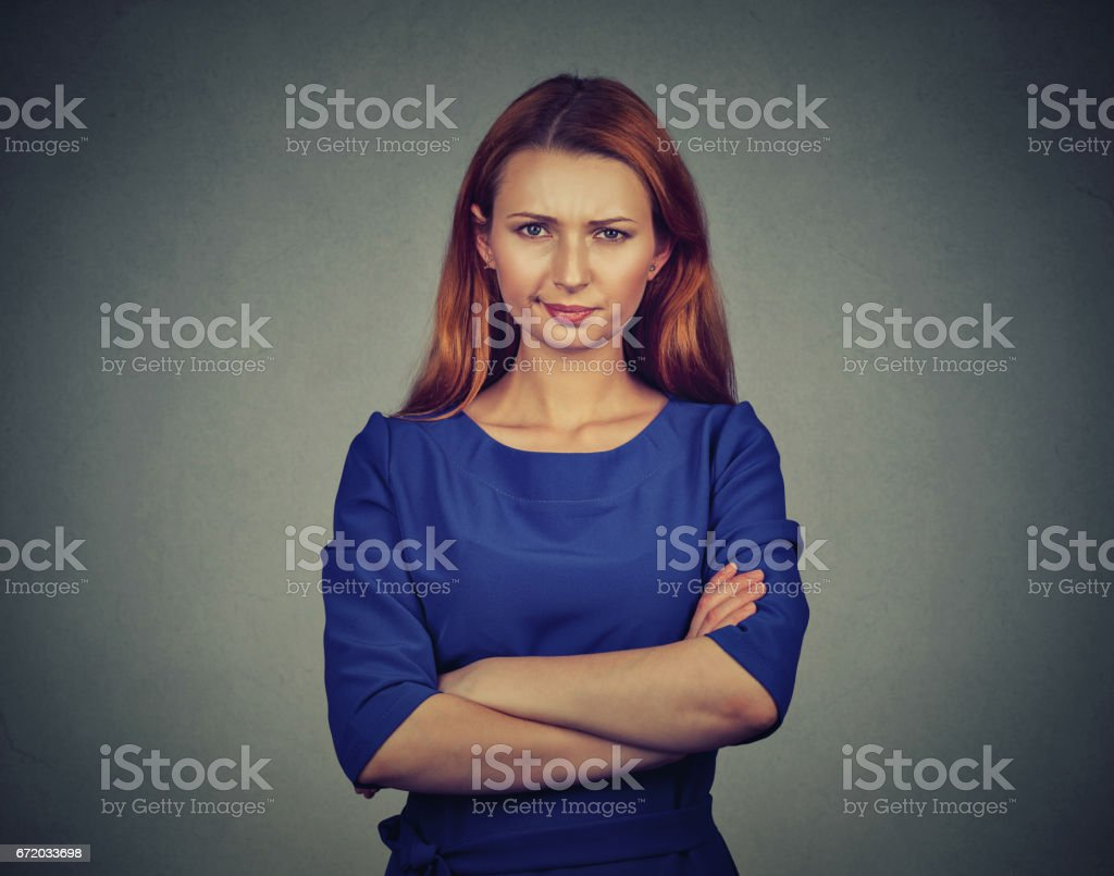 angry young woman, being skeptical, displeased stock photo