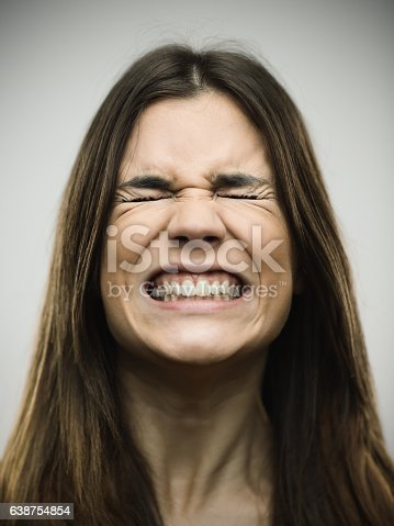 istock Angry young woman clenching teeth 638754854