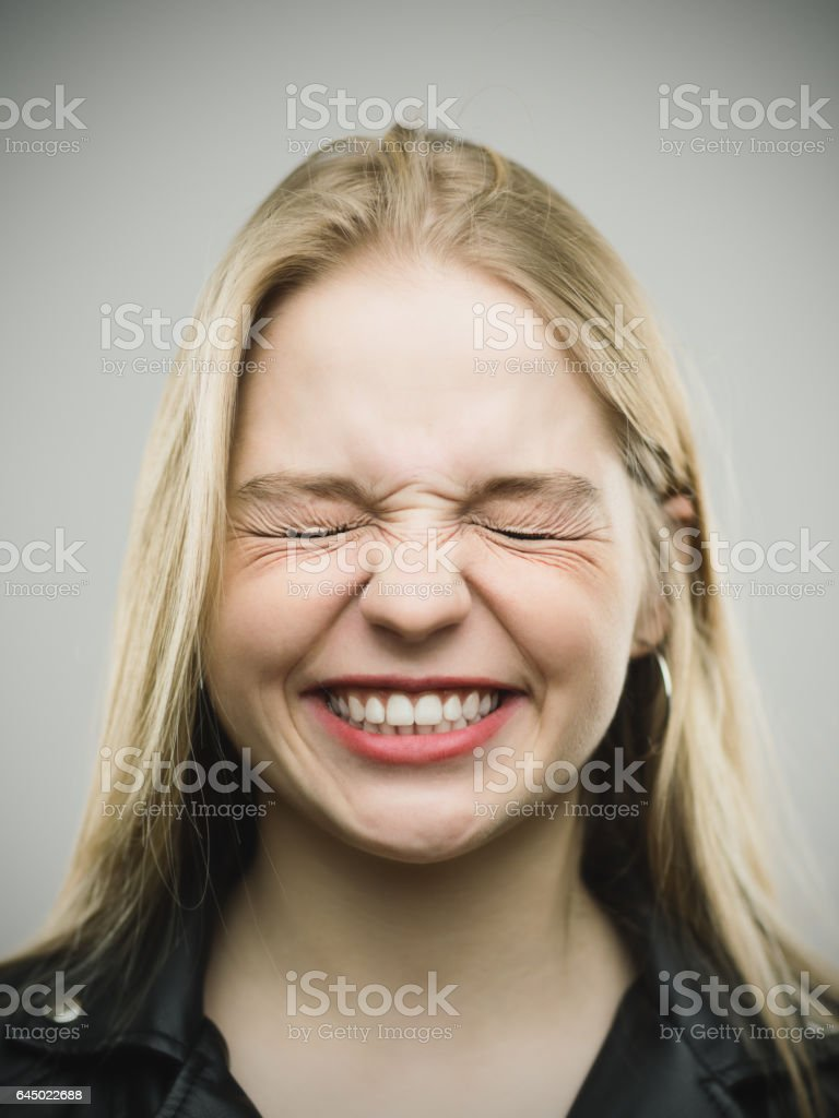 Angry young woman clenching teeth stock photo