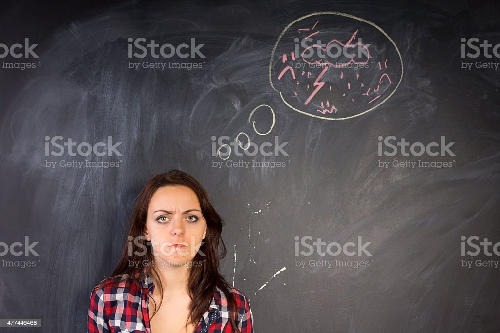 Angry young woman glaring at the camera stock photo