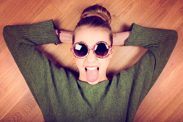 angry young woman - sticking out tongue stock photos and pictures