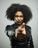 istock Angry young woman pointing at you 666991350