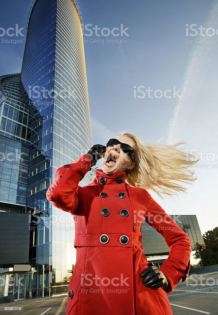 Angry young woman with a mobile phone royalty-free stock photo
