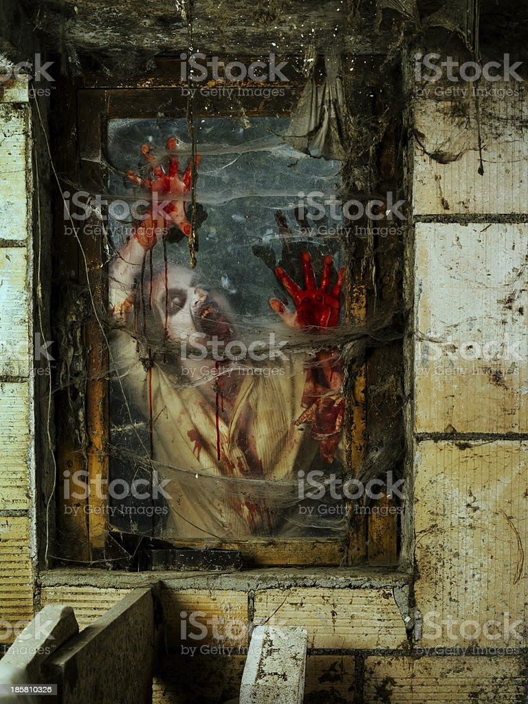 Angry zombie at the window royalty-free stock photo