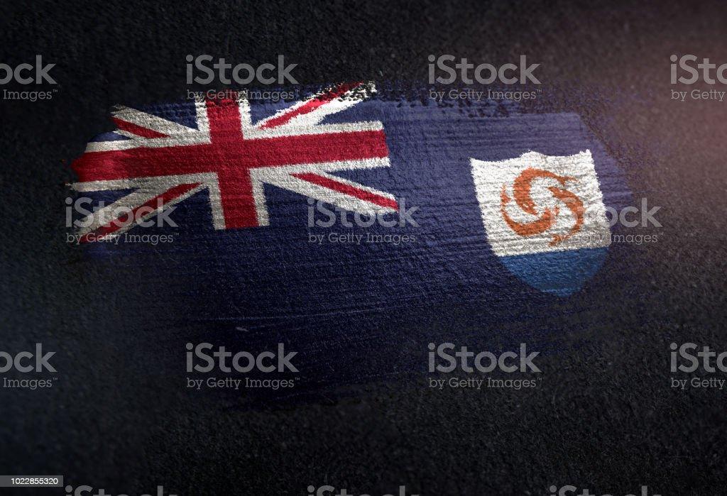 Anguilla Flag Made of Metallic Brush Paint on Grunge Dark Wall stock photo