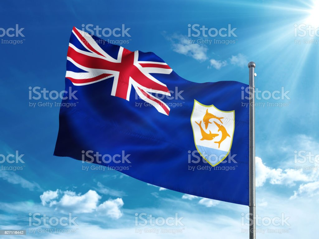 Anguilla flag waving in the blue sky stock photo