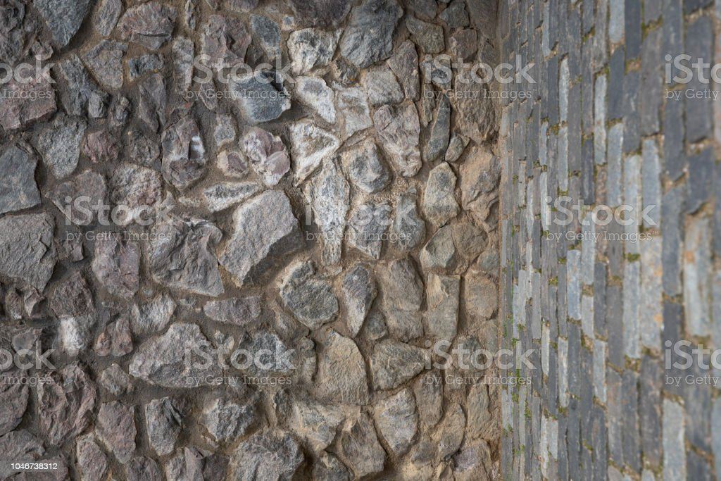 angular wall under the angle of stone and concrete stock photo