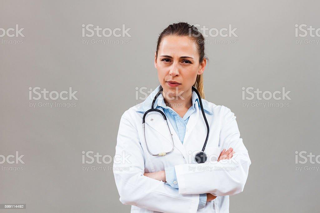 Angy female doctor thinking stock photo