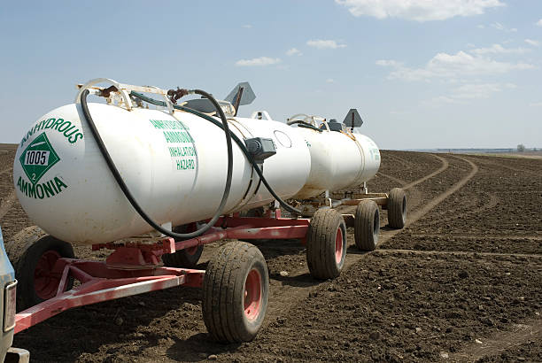 Anhydrous Ammonia Anhydrous Ammonia tanks in newly planted wheat field anhydrous stock pictures, royalty-free photos & images