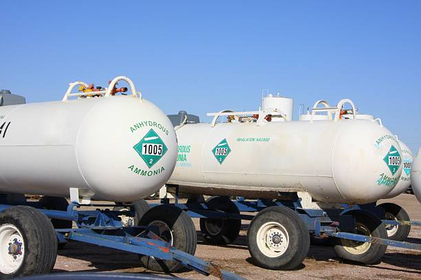 Anhydrous Ammonia Tanks are Ready to Roll These anhydrous tanks filled with nitrogen fertilizer at a farmers' cooperative in western Iowa are ready to head to the field to fertilize cornfields.  anhydrous stock pictures, royalty-free photos & images