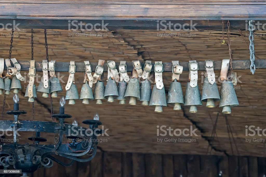 Animal bell hanging on a pole stock photo