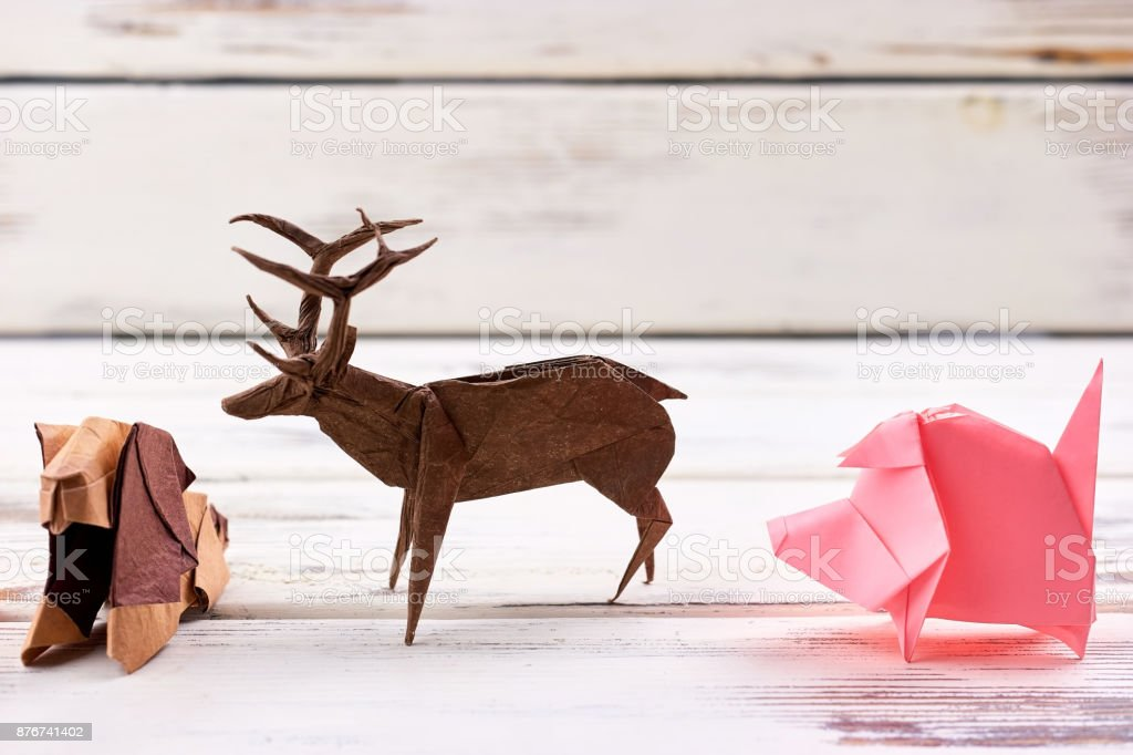 Animal figurines on wooden background stock photo