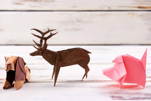 Animal figurines on wooden background stock photo