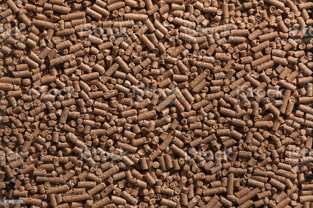 Animal food pellets. Background texture stock photo