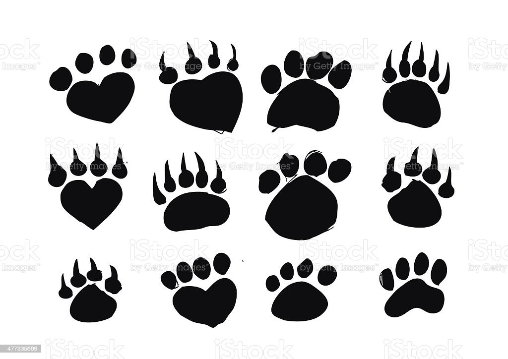 Animal footprints silhouettes stock photo