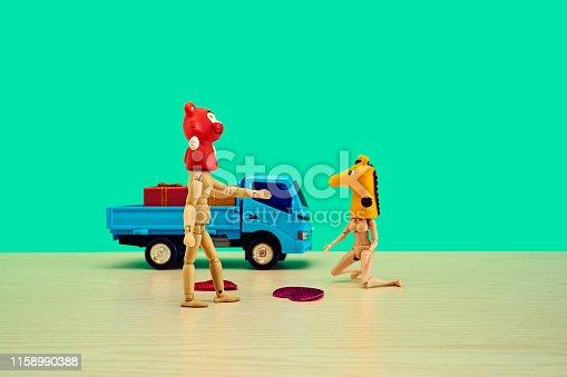 Wooden desk, animal mask, toy truck, doll,color background,