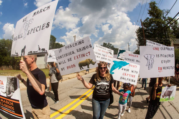 Animal Rights Activists Walk With Signs In Atlanta Festival Parade stock photo