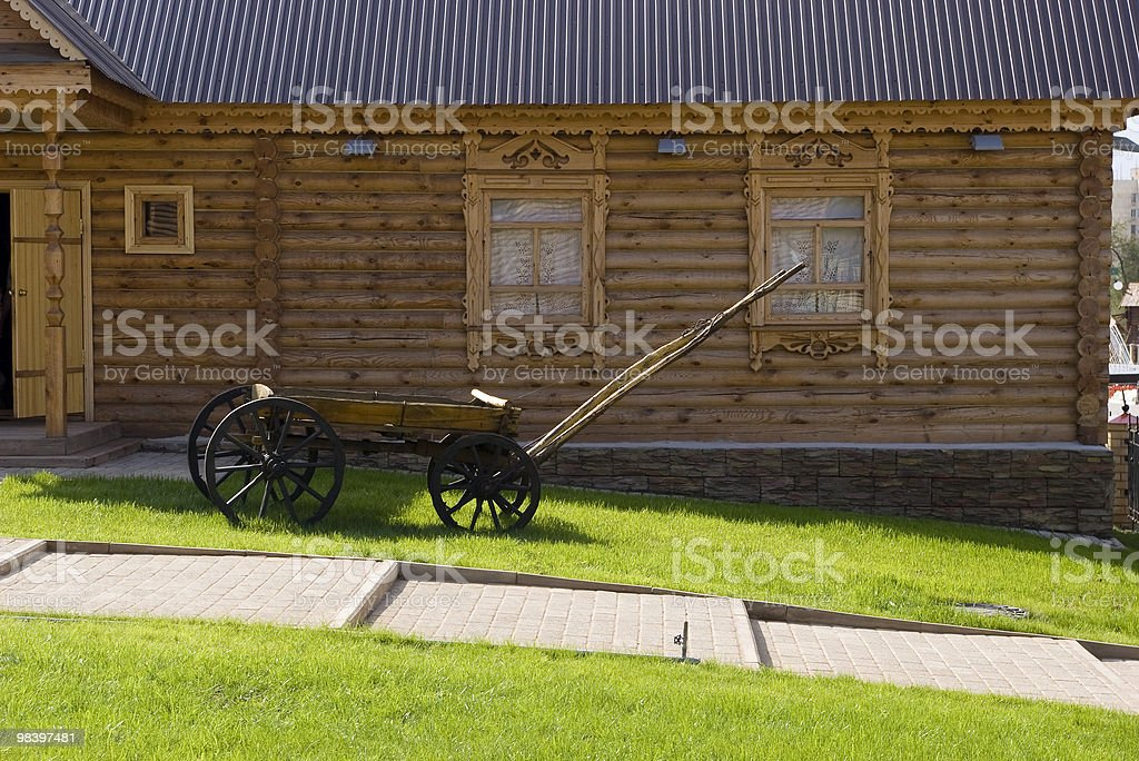 Animal-drawn vehicle near the house. royalty-free stock photo