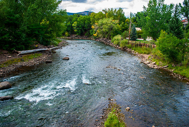 Animas River Flowing in summer Pre-Toxic Spill Conditions Animas River Flowing in summer Pre-Toxic Spill Conditions. This photo of the Animas River was taken years before the Silverton Mine spilled 3 million gallons of Toxic wastewater into the river here in Durango, Colorado animas river stock pictures, royalty-free photos & images