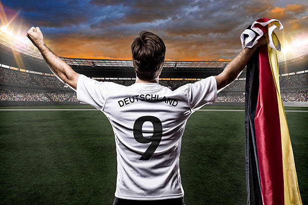 animation of a german soccer jersey in a stadium with a flag - sports uniform stock photos and pictures
