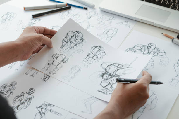 Animator designer Development designing drawing sketching development creating graphic pose characters sci-fi robot Cartoon illustration animation video game film production , animation design studio. stock photo