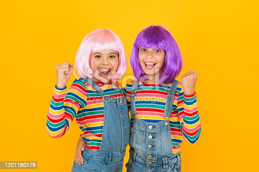 Anime fan. Animation style characterized colorful graphics vibrant characters fantastical themes. Anime convention. Happy little girls. Cheerful friends in colorful wigs. Anime cosplay party concept.