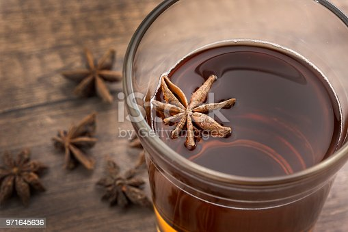 aroma tea cup anis and seeds with wooden background with artificial light studio High view Horizontal orientation.