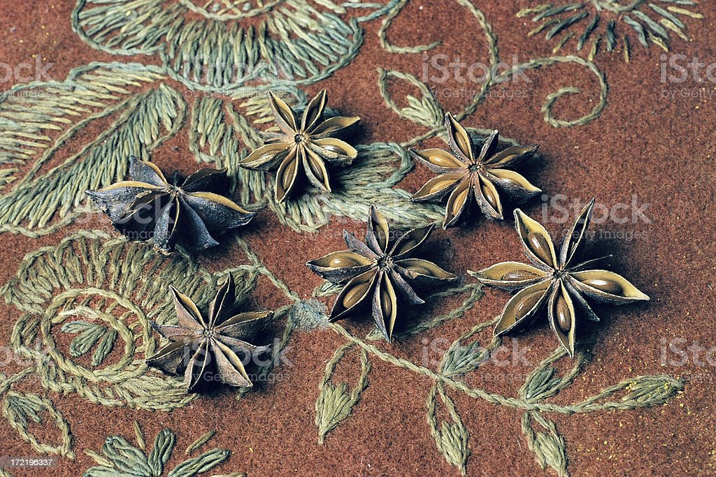 Anise on a brown Table Runner stock photo