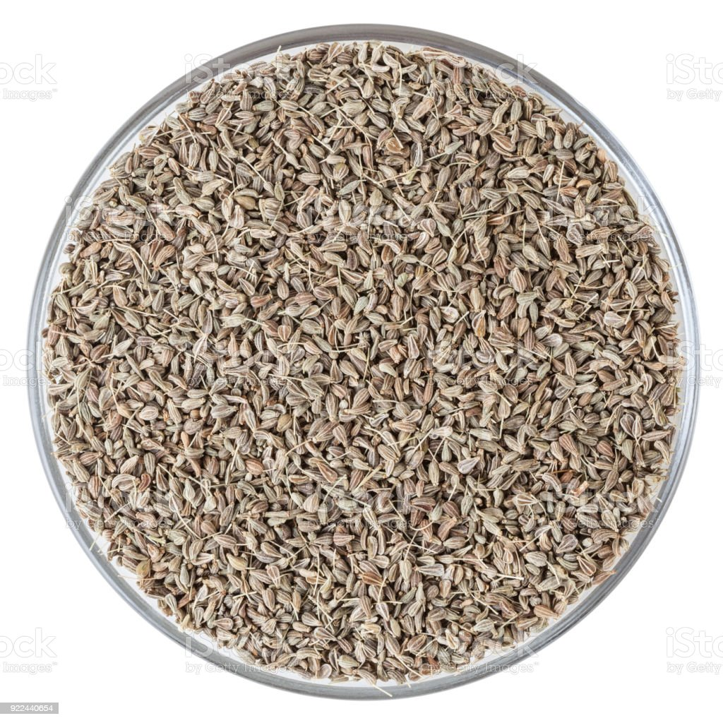Anise seeds in glass bowl isolated on white background with clipping path stock photo