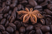 istock Anise star on roasted coffee beans background. Close up. Perfect spice combination concept. 1280411310