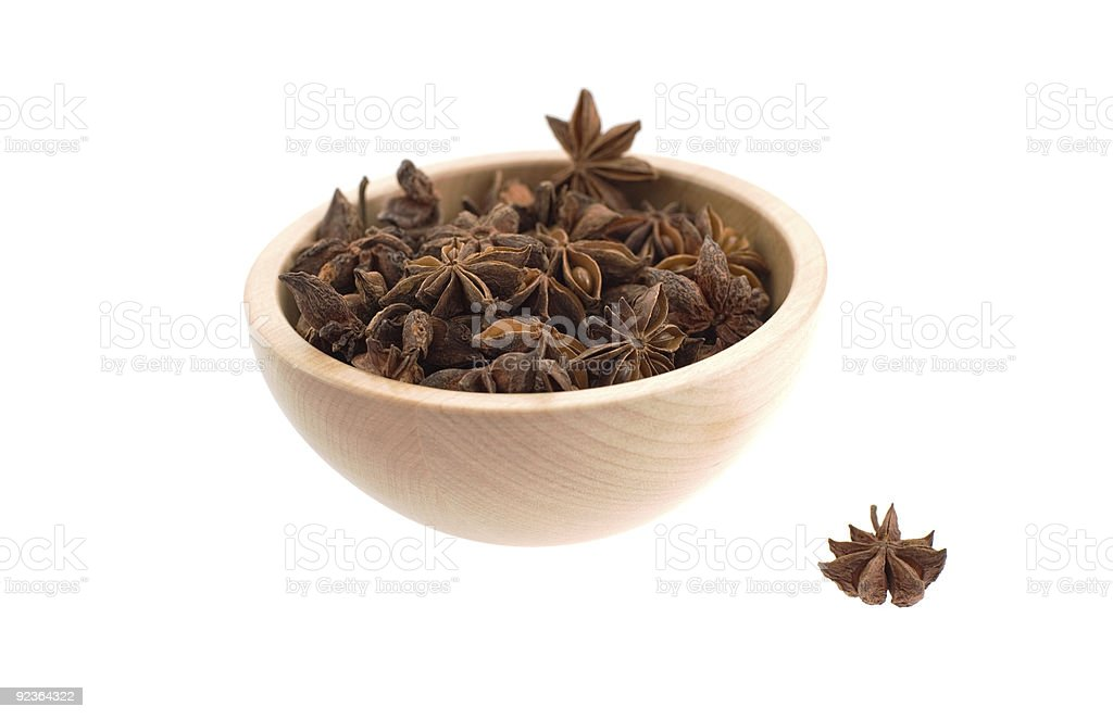 anise stars in a wood bowl royalty-free stock photo