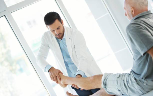 Ankle examination. stock photo