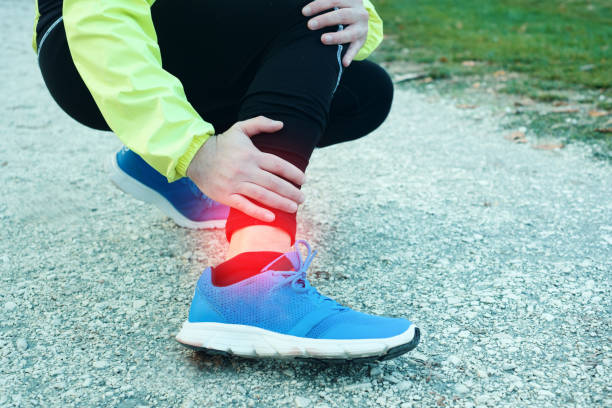 ankle injury and man runner exercising with leg pain - slogatura foto e immagini stock