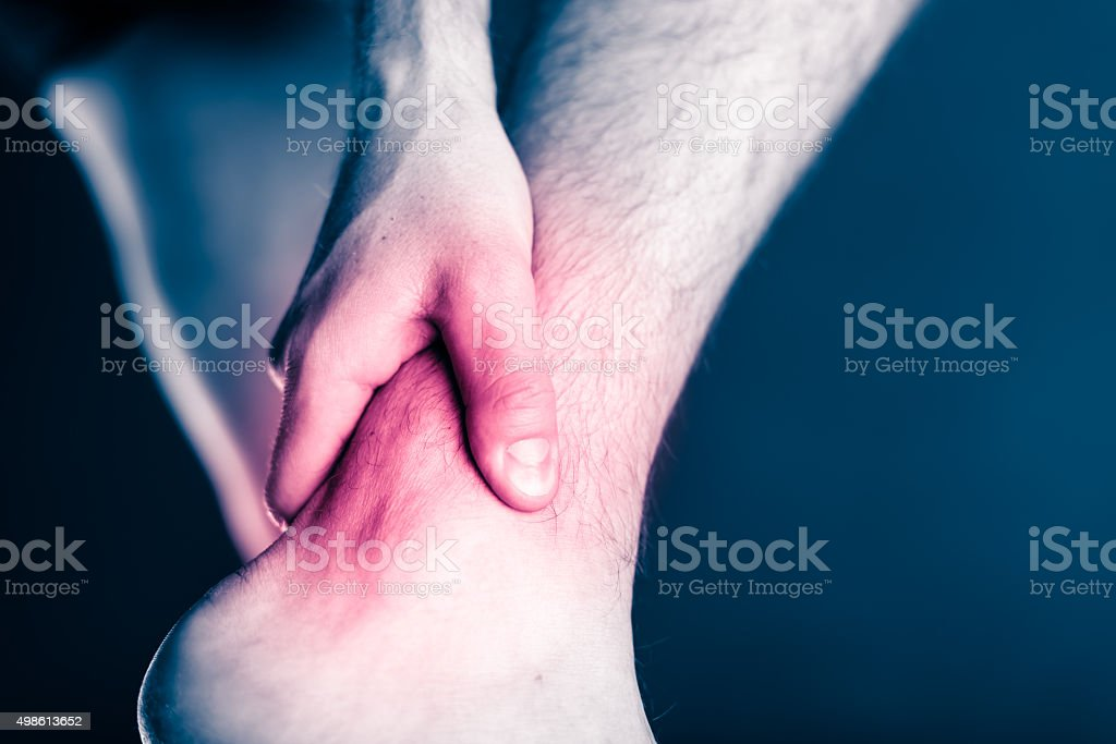 Ankle pain, physical injury painful leg stock photo