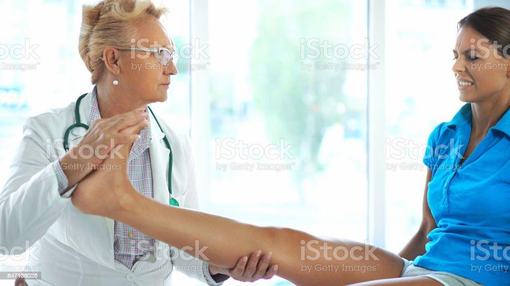 Ankle sprain examination. stock photo