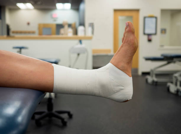 Ankle Tape Job on a varsity athlete in the clinic stock photo