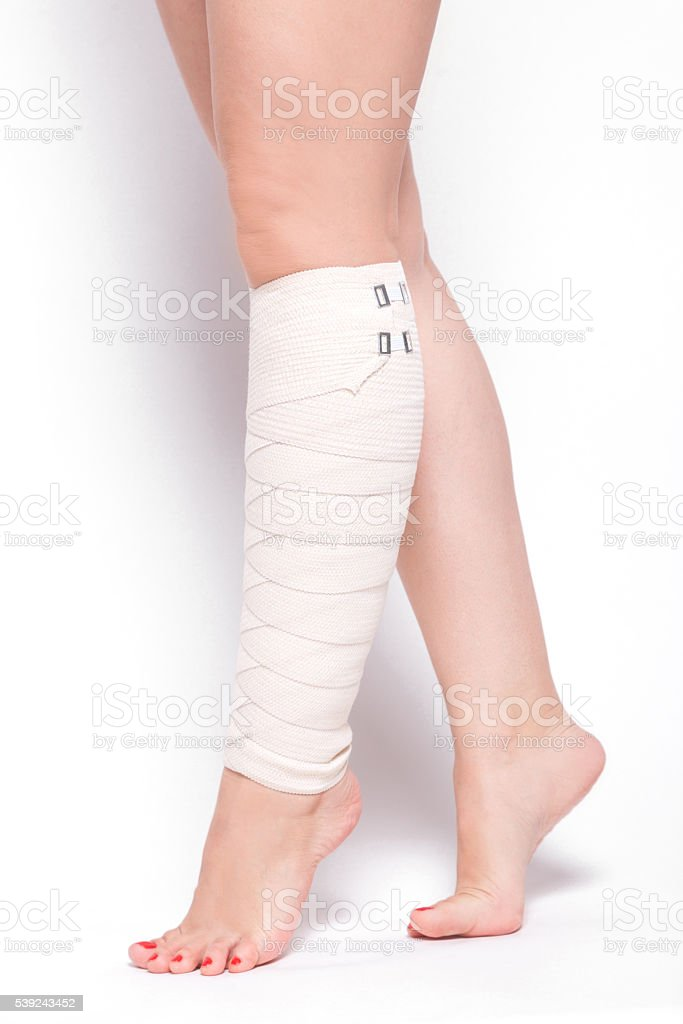 ankle woman on a white background dragged elastic bandage royalty-free stock photo