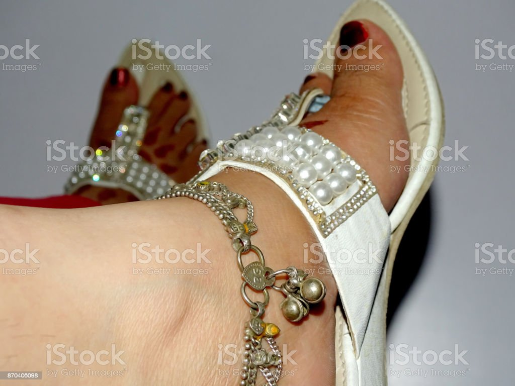 anklet in the foot stock photo