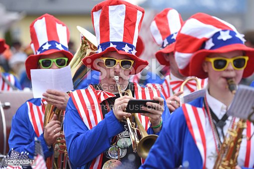 Carnival in the Salzkammergut - here there is still a proper celebration - on the picture an american brass-band at a carnival event (Upper Austria, Austria)