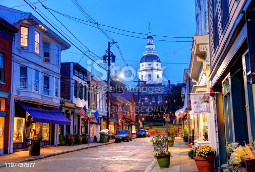 Annapolis, Maryland, USA - November 15, 2019: Morning view of shops along Maryland Ave with the Maryland State House in the background.