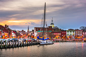 Annapolis, Maryland, USA from Annapolis Harbor at dusk.
