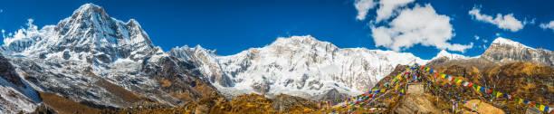 Annapurna 8091m base camp prayer flags Himalaya mountains panorama Nepal stock photo