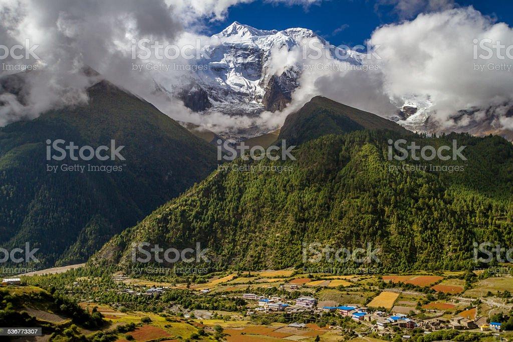 Annapurna Mastif Looms over Pisang, Nepal stock photo