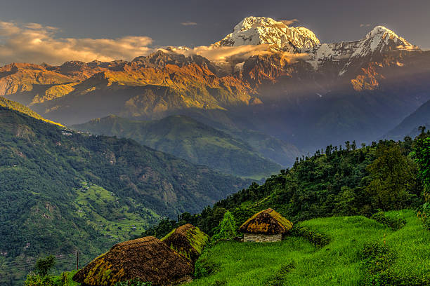 Annapurna South view from Tolka village at sunrise stock photo