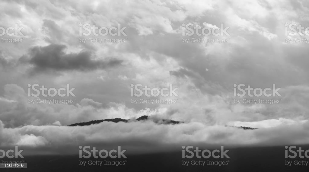 Annecy, France A view of the Alps at Annecy, France, with the slopes of the Alps visible through low cloud. 2019 Stock Photo