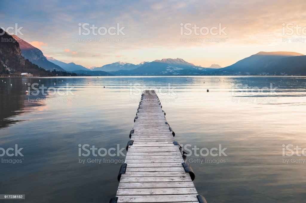 Annecy lake in French Alps at sunset stock photo