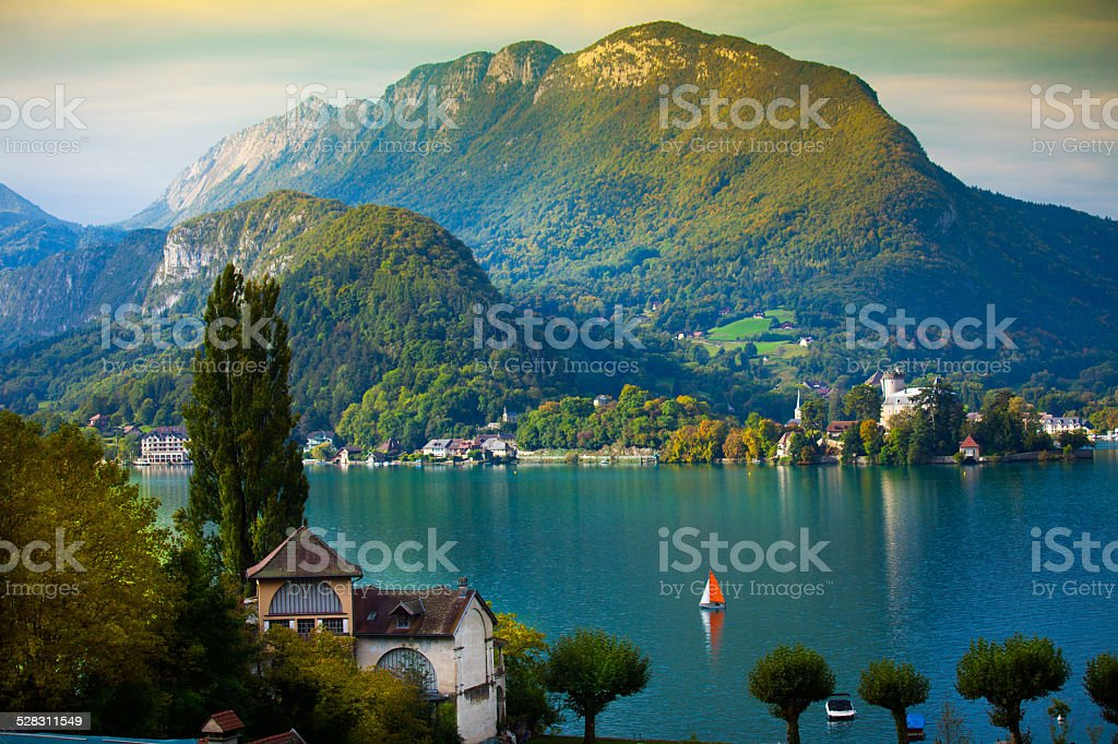 Annecy Lake with sailboat stock photo