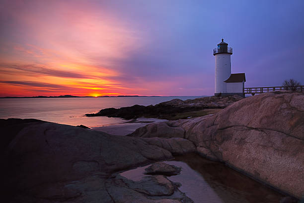 Annisquam Lighthouse Sunset Annisquam Lighthouse at Sunset. Located in northern Gloucester Massachusetts. gloucester massachusetts stock pictures, royalty-free photos & images