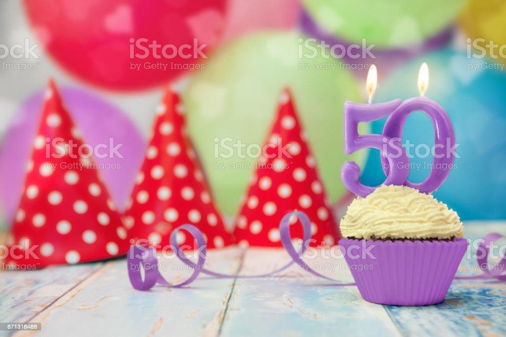 50 anniversary birthday cupcake with candle stock photo