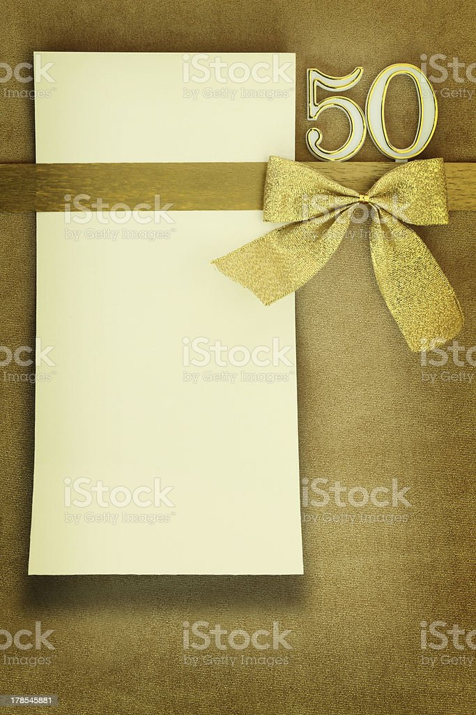 Anniversary card on golden background stock photo